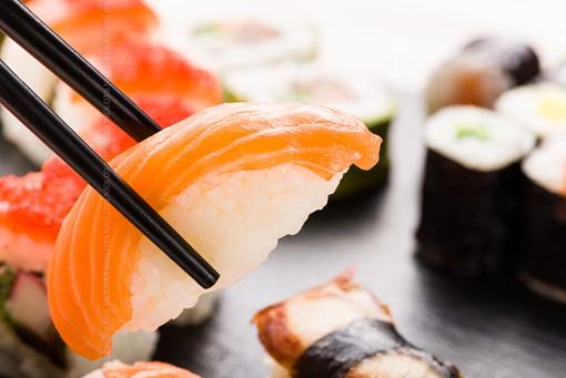 Sushi with chopsticks closeup
